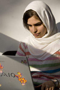 Middle Eastern student w laptop 2 CCCIE